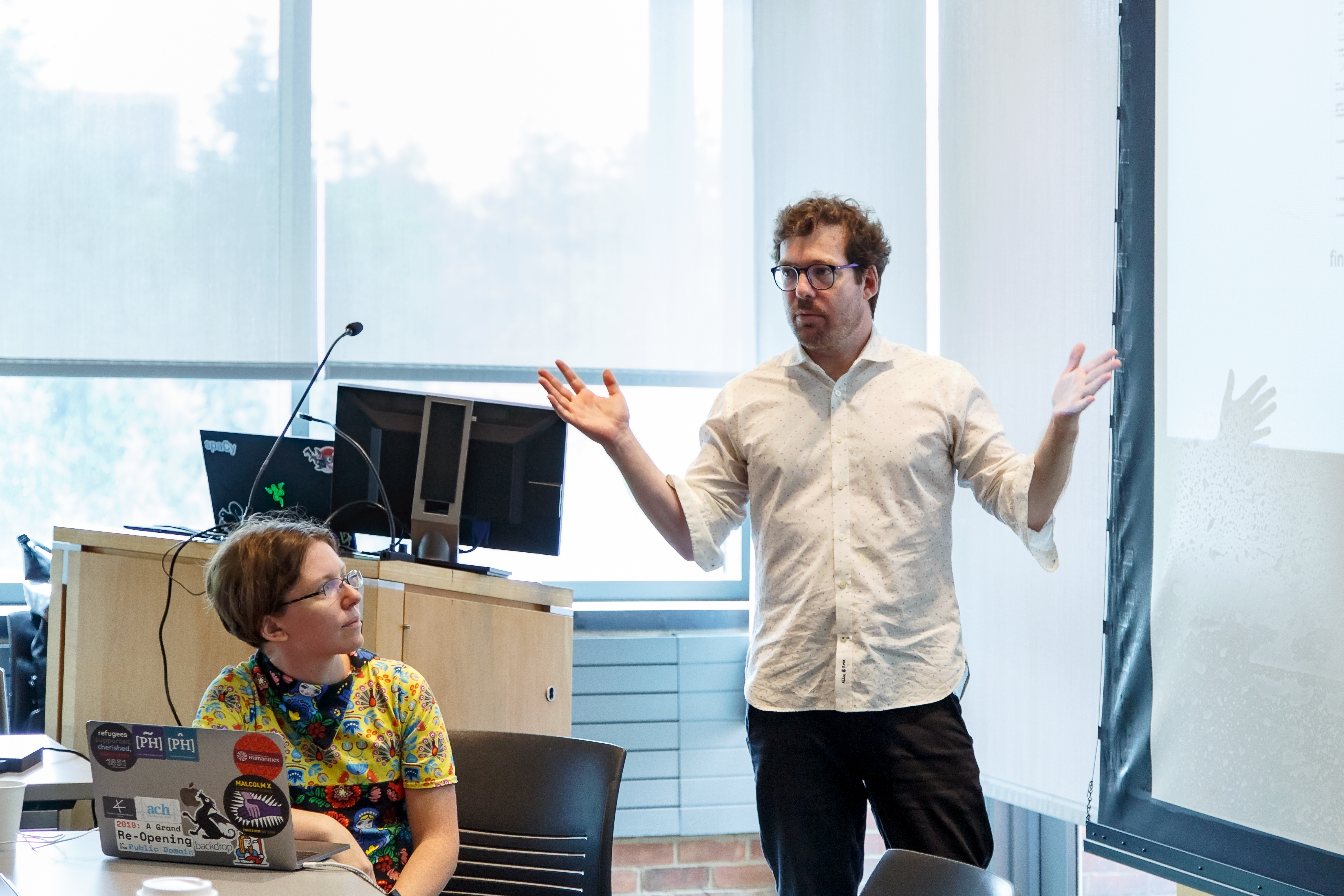 Photos of Institute instructor Quinn Dombrowski (Stanford University) and Project Co-Director Andrew Janco (Haverford College) teaching a course on computer vision at the 2019 Slavic DH Summer Workshop at Princeton.